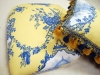 Blue and Yellow Toile Pillow with Tassel Trim and Upholstered Seat