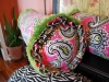Large Paisley Bolster with Brush Fringe Trim and Pleated Ruffle Edge.
