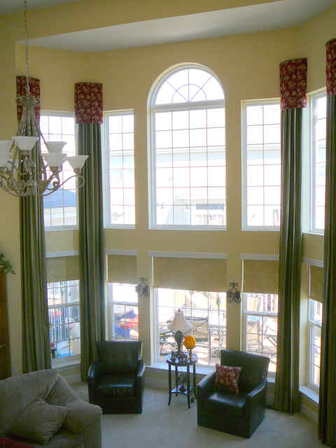 2-story-window-green-drapes-with-red-valance