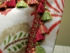 Close up of Floral Pillow with Flange edge and tassel Trim