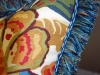 Close up of Pillow with Brush Fringe.