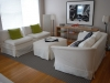 slipcovers-withskirt-on-armless-chairs-and-ottoman-and-loveseat