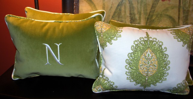 Green velvet pillows with monograming.