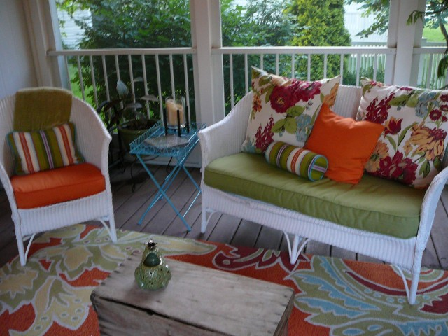 Pillows, cushions, blue table, wicker furniture