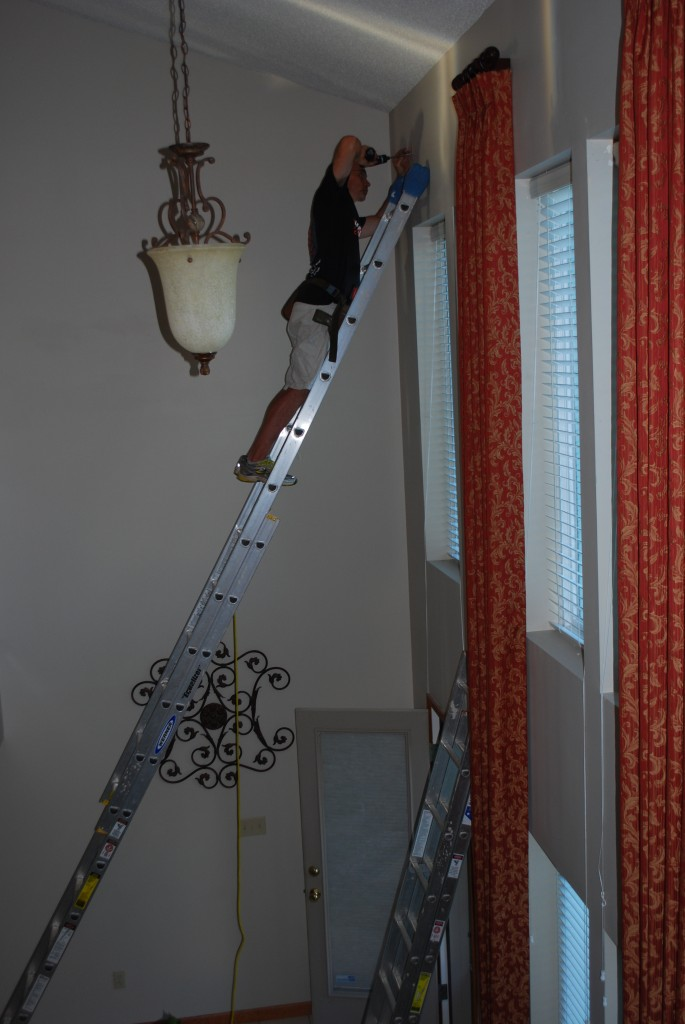 2 - Story Install of Drapery Panels on Rod and rings.
