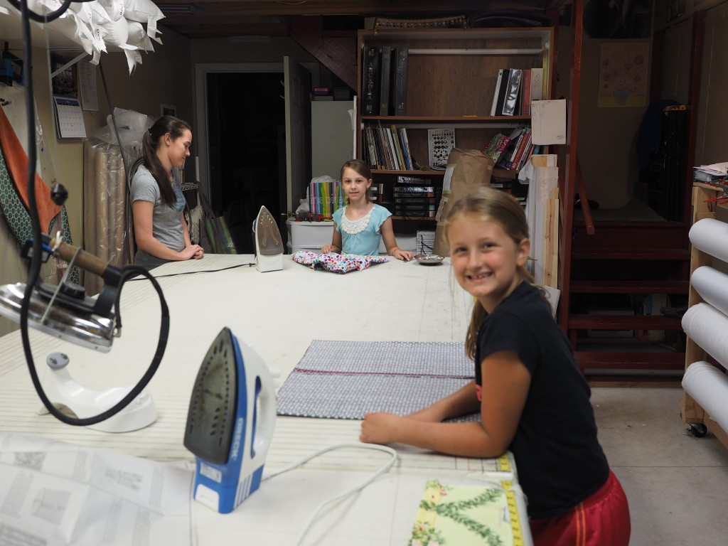 4-H girls working on skirts.