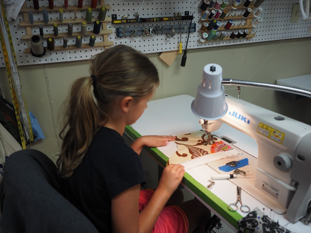 4-Her's practicing on industrial sewing machine